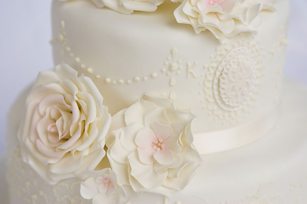 Delicate Piped Lace and Brushed Embroidery with Large Sugar Roses.