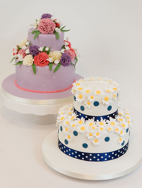 Two Tier Celebration Cakes, Lavender with Coronations, White & Blue with Daisies