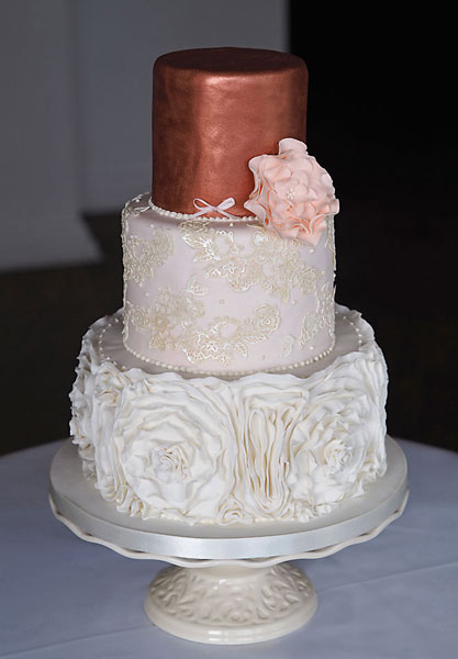 Rose Gold Ruffle Wedding Cake, Delicate Sugar Ruffles, Lace with Ivory Shimmer and Metallic Rose Gold Top. Finished with a Large Blush Sugar Open Rose.